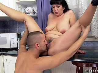 Sizzling granny gobbles down on this throbbing prick