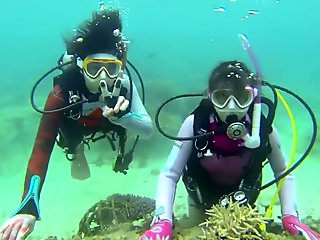 Two Japanese girls scuba diving in a TV program.
