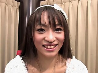 Funky Japanese babe chats to the camera in an interview